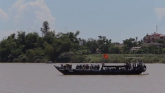 WS PAN Boat Going by with Vietnamese Flag / Vietnam Stock Footage