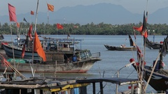 WS LD Vietnamese Flags on Wooden Boats Waving in Breeze / Vietnam Stock Footage