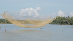 BOAT POV WS Traditional Fishing Net Resting Above Water / Vietnam Stock Footage
