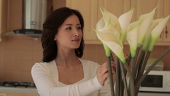 MS Woman arranging Calla lilies in kitchen / China Stock Footage