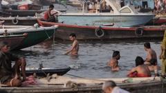 WS People bathing in Ganges / Varanasi, India Stock Footage