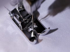 Sewing machine makes a stitch of black thread. Slow motion Stock Footage