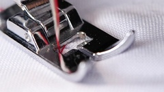 Sewing machine zigzag stitch scribbling. Close up. Slow motion Stock Footage
