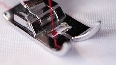Process of sewing on the sewing machine. Slow motion Stock Footage