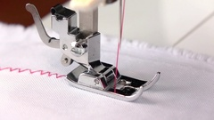 Sewing machine. Zigzag seam with different thread tension. Slow motion Stock Footage