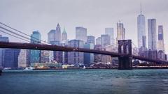 Timelapse day to night. Rainy Manhattan and the Brooklyn Bridge Stock Footage