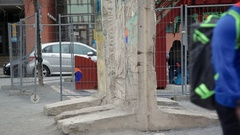 Kids play on old pieces of the Berlin Wall, Potsdamer Platz, Germany Stock Footage