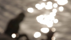 WS DEFOCUSED Light shimmering in water / India Stock Footage
