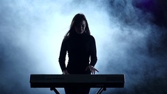 Electronic piano. Woman dancing to music played. Slow motion. Studio Stock Footage