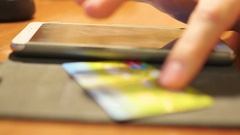 Hand a wire transfer of money with credit card using a smartphone Stock Footage