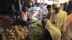 WS Man selling fruit and vegetables in market / India Stock Footage