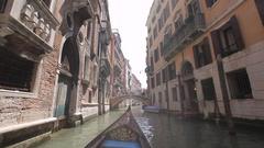 BOAT POV WS Gondola Floating down Narrow Canal / Venice, Italy Stock Footage