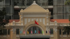 MH LD Flags Waving on National Treasury Building / Ho Chi Minh, Vietnam Stock Footage