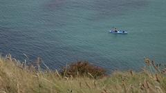 WS HA LD Man Rowing Kayak in Sea / Cornwall, England, UK Stock Footage