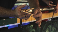 Puppeteer playing with a marionette Stock Footage