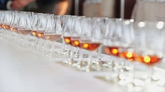 Alcohol glasses lined up in a row Stock Footage