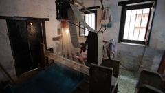 WS PAN Men weaving on looms / India Stock Footage