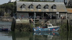 WS Fishing Boat Moored Next to Building / Cornwall, England, UK Stock Footage