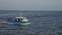 WS PAN Fishing Boat Going Past Lighthouse / Cornwall, England, UK Stock Footage