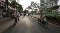 REAR POV WS Motorcycle Traffic Along Busy Street / Ho Chi Minh, Vietnam Stock Footage