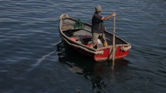 WS Man Rowing Boat in Water / Cornwall, England, UK Arkistovideo