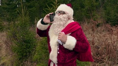 Santa Claus talking on phone and laughing Stock Footage
