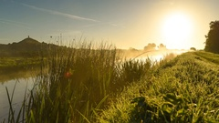 Sunrise and misty dawn over Glastonbury Tor and Somerset Levels Stock Footage