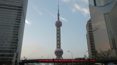 WS The Oriental Pearl Tower with Chinese ticker board in foreground / Shanghai, Stock Footage