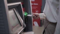 Young woman inserting a credit card to ATM, beautiful girl banking Stock Footage