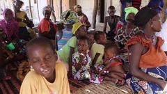 Woman and children natives in village - Guinea Africa Stock Footage