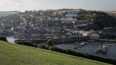 WS HA Harbour and Village on Hillside / Cornwall, England, UK Stock Footage