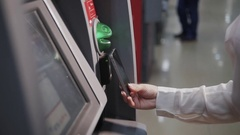 Smiling young woman withdrawing money from ATM using phone contactless pay Stock Footage