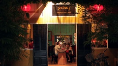 WS LD People in Restaurant at Night / Hoi An, Vietnam Stock Footage