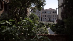 WS LD Boat Going by in front of Buildings with Courtyard in Foreground / Venice, Stock Footage