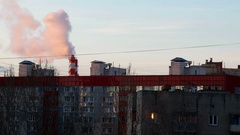 Boiler house chimney. Steam against the clear blue sky. Industrial zone. Stock Footage