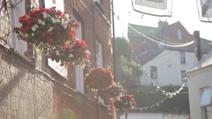 MH LA Potted Flowers Hanging from Windows of Houses / Cornwall, England, UK Stock Footage
