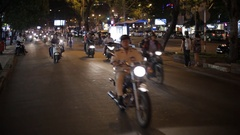 WS LD Motorcycle Traffic Going down Busy Road at Night / Ho Chi Minh, Vietnam Stock Footage