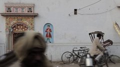 MS People going past ornate doorway / Varanasi, India Stock Footage