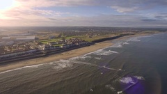 Beautiful British seaside town with sun setting down, aerial view Stock Footage