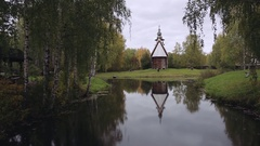 Wooden Church in Kostroma, aerial shot. flying over the river Stock Footage
