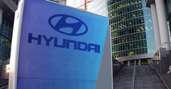 Street signage board with Hyundai Motor Company logo. Modern office center Stock Footage