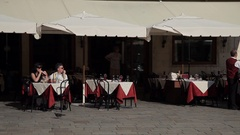 WS LD People Sitting in front of Cafe / Venice, Italy Stock Footage