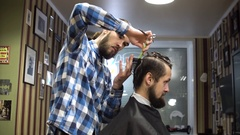 Male barber and client are talking about haircut, smiling and laught Stock Footage