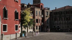 WS TU Small Square with Church Spire / Venice, Italy Stock Footage