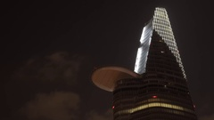 T/L MH LA LD Clouds Going by Bitexco Financial Tower at Night / Ho Chi Minh, Stock Footage