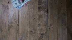 Man Hands Consider Dollar Banknotes on a Wooden Table. Slow Motion Stock Footage