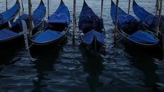 WS LD Gondolas Moored in Water / Venice, Italy Stock Footage