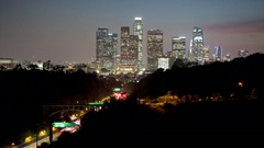 Time lapse of traffic on the 110 freeway and downtown Los Angeles at dusk. Stock Footage