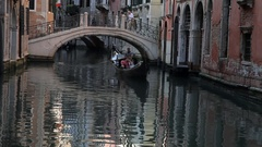 WS LD Gondola Floating down Canal in Fornt of Bridge / Venice, Italy Stock Footage