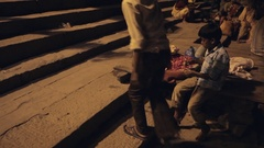 WS Young boy sitting on steps selling sweets / Varanasi, India Stock Footage